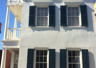 white exterior and blue shutters